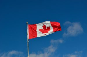 canadian flag canada wind blue sky