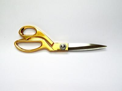 scissors cutting gold